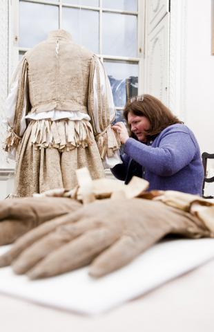 Rosamund mounting the C16 suit of Edmund Verney. Image courtesy National  Trust