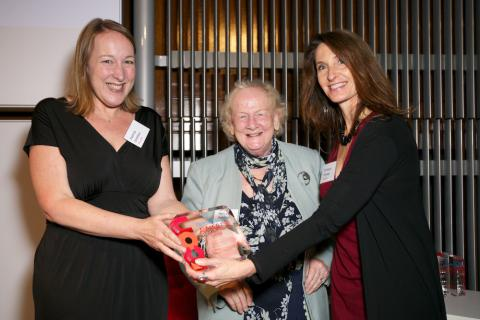 Patricia Smithsen and Bronwyn Ormsby receiving the Award from Baroness Sharp.